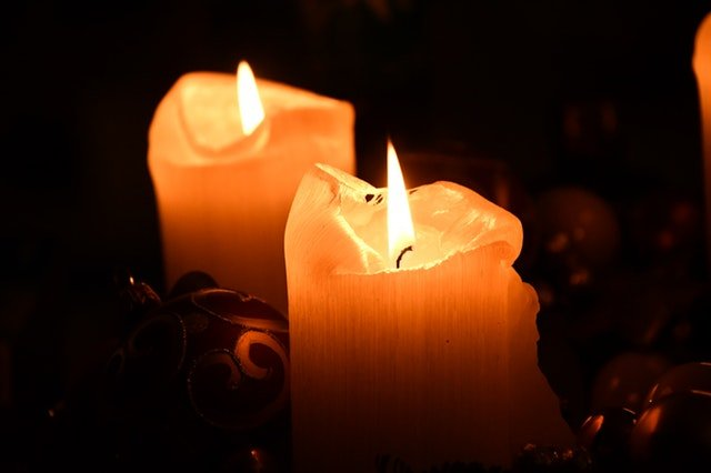 Melted, burning candles