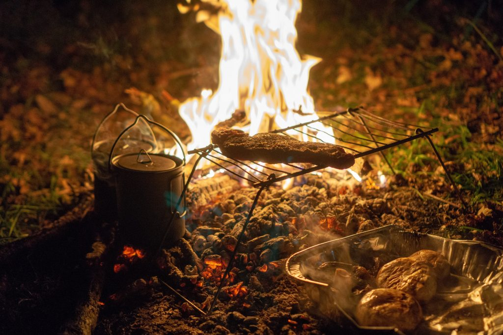 Cooking over a fire is an important skill in bushcraft camping