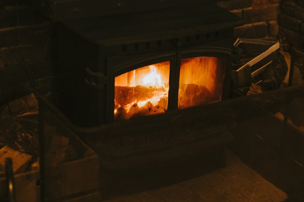 Dark wood stove with fire inside
