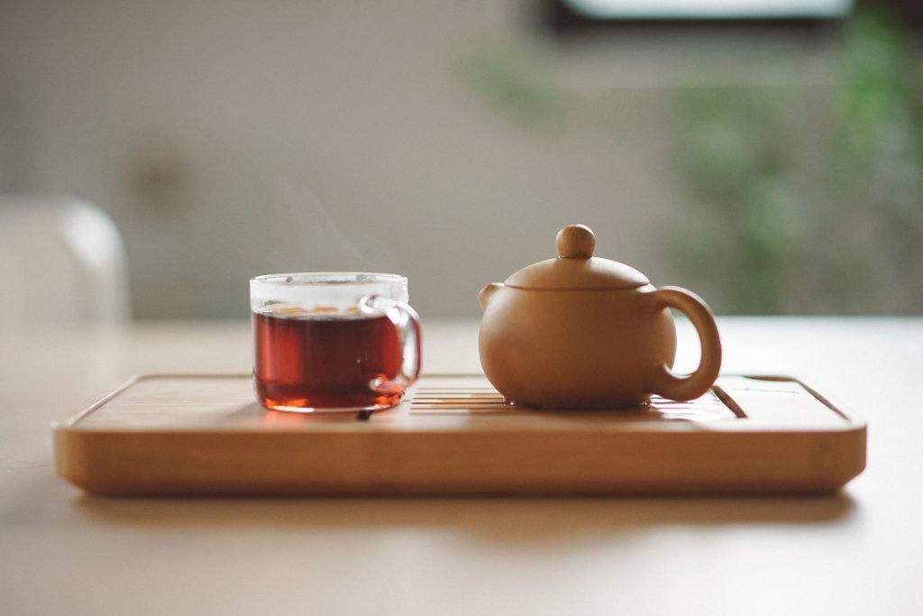 teapot and cup of tea on a serving tray